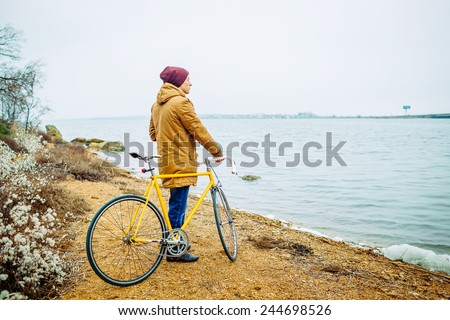 Cyclist the Bike on the Beautiful Spring Mountain Trail - stock photo
