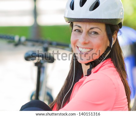 Cyclist Woman Listening To Music, Outdoors - stock photo