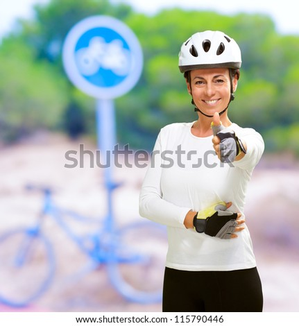 Cyclist Woman Showing Thumb Up, Outdoor - stock photo