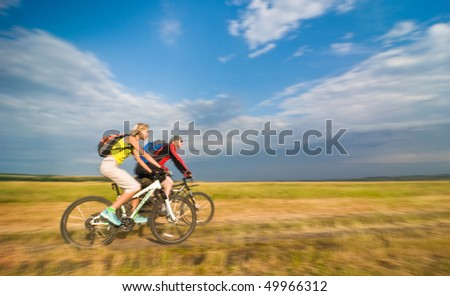 cyclists biking in motion - stock photo
