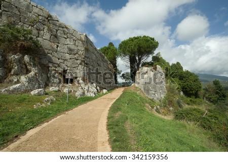 Cyclopean walls in Norba ancient town in Lazio, Italy - stock photo