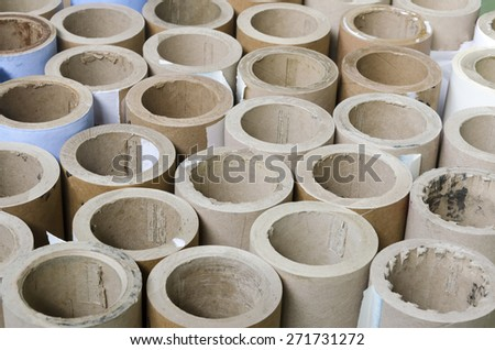 Cylinders cardboard background of Rolled paper in offset printing house - stock photo