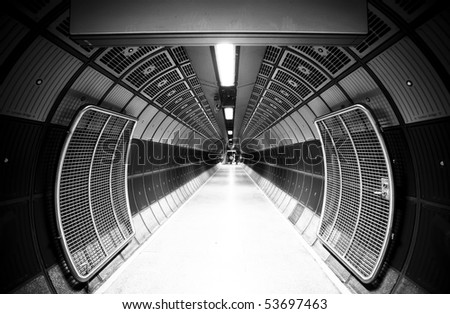 Cylindric tunnel for pedestrians, monochrome toned. - stock photo