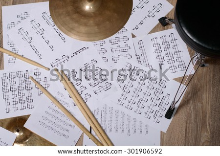 Cymbal. notes and drumsticks. Drums - stock photo