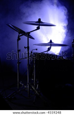 cymbals set in blue light of searchlights. more light - stock photo