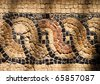 Cyprus Paphos mosaic in the House of Dionysos with shadows thrown by late afternoon sunshine - stock photo