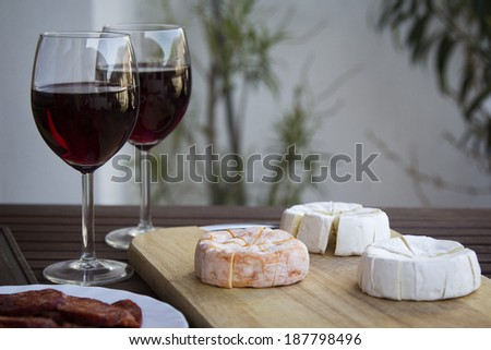 Czech Hermelin cheese and wine glasses - stock photo