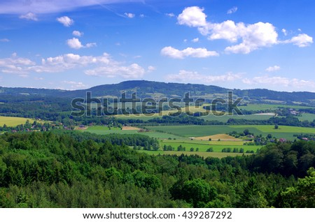 Czech landscape with mountains, clouds and trees