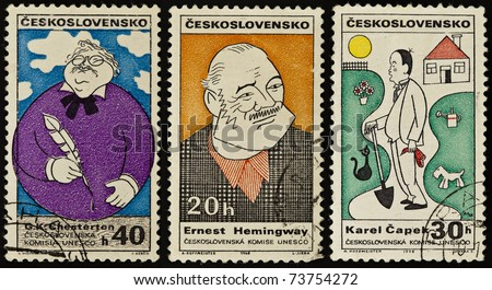 CZECH REPUBLIC - CIRCA 1968-1969: A post stamps printed in Czechoslovakia shows Karel Capek, Ernest Hemingway and G.K. Chesterton, circa 1968-1969 - stock photo