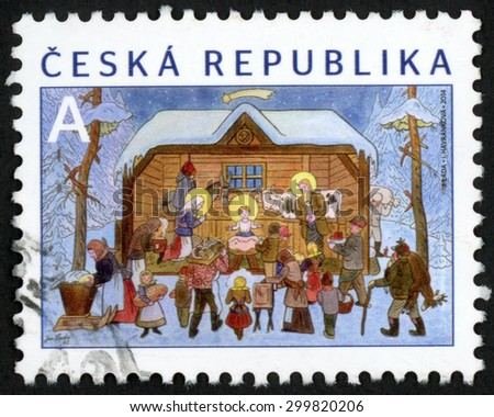 CZECH REPUBLIC - CIRCA 2014: Christmas post stamp printed in Czechoslovakia (Ceska) shows birth of Jesus Christ at Bethlehem painting by Josef Lada; circa 2014 - stock photo