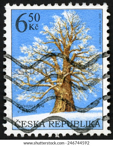 CZECH REPUBLIC - CIRCA 2004: post stamp printed in Ceska (Czechoslovakia) shows singing lime tree covered with snow in winter; Teleci; famous trees; Scott 3248 6.50k blue brown white, circa 2004 - stock photo