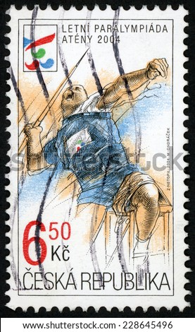 CZECH REPUBLIC - CIRCA 2004: post stamp printed in Czechoslovakia (Ceska) shows illustration of male athlete throwing javelin; summer paralympics, Athens; Scott 3245 A1254 6.50k multicolor, circa 2004 - stock photo