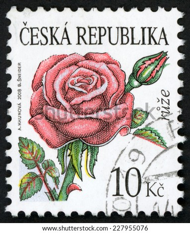 CZECH REPUBLIC - CIRCA 2008: post stamp printed in Czechoslovakia (Ceska) shows illustration of red rose (rosa, ruze) flower on white background; 10k red green, circa 2008 - stock photo
