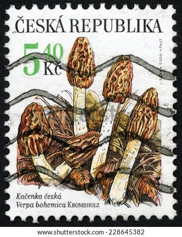 CZECH REPUBLIC - CIRCA 2000: post stamp printed in Czechoslovakia shows illustration of five Verpa bohemica (kacenka ceska; early false morel) edible mushroom; Scott 3127 A1179 5.40k brown, circa 2000 - stock photo