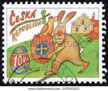 CZECH REPUBLIC - CIRCA 2009: stamp printed in Ceska shows symbols of Easter: running rabbit with painted egg & hatched chick, house, dog, pussy willow whip (rod); Scott 3413 10k, circa 2009 - stock photo