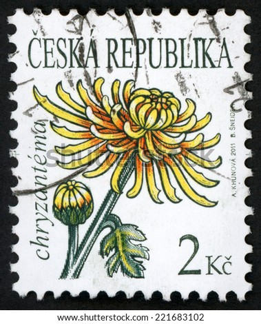 CZECH REPUBLIC - CIRCA 2011: stamp printed in Czechoslovakia (Ceska) shows illustration of yellow chrysanthemum (chryzantema, chrysanths, mum) flower on white; beauty of flowers series; 2k; circa 2011 - stock photo