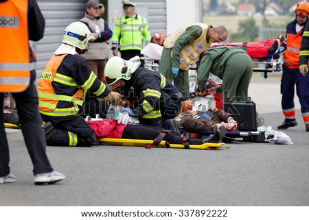 CZECH REPUBLIC, PLZEN, 30 NOVEMBER, 2015: A team of emergency medical services at work,wounded on a stretcher at the scene of a car crash  - stock photo
