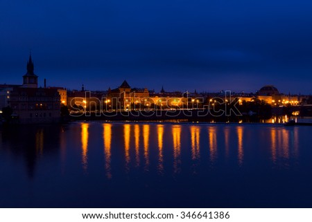Czech Republic. Prague. Cloudy morning over the Vltava river. The city lights reflected in the water. Traffic