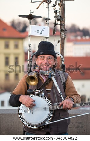 CZECH REPUBLIC, PRAGUE, DECEMBER 03 2015. Multi-instrumental musician on Prague's Charles Bridge, amazing show. Prague, Czech republic, 3rd December 2015 - stock photo