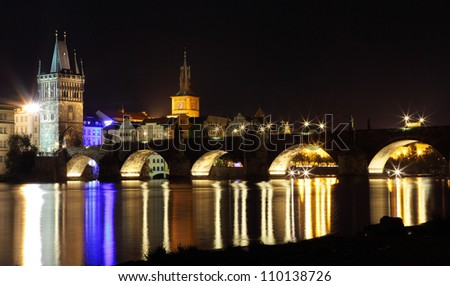 czech republic prague - illuminated charles bridge at dusk in summer - stock photo