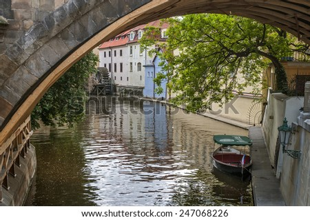 Czech Republic, Prague . Kampa Island , also known as Venice of Prague , in the Mala Strana , the old houses are reflected in the narrow river Devil (Czertovka). The old watermill . - stock photo