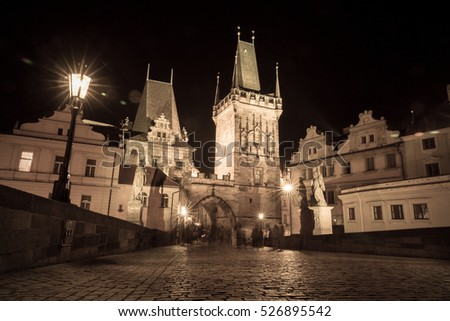 Czech Republic, Prague. Night view of the Charles Bridge in the style of an old photo