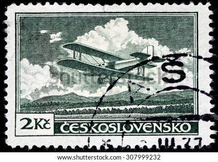 CZECHOSLOVAKIA - AUGUST 10, 2015: A stamp printed by CZECHOSLOVAKIA shows Letov S-19 Smoliks - an airplane produced in Czechoslovakia during the 1920s, circa December, 1930. - stock photo