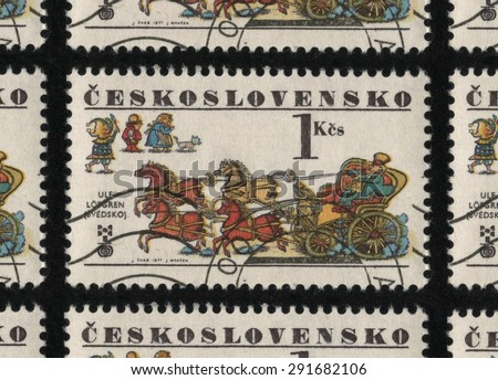 "CZECHOSLOVAKIA - CIRCA 1977: A postage stamp printed in Czechoslovakia from  ""The 6th Biennial Exhibition of Children's Book Illustrators, Bratislava"" issue, showing a horse drawn carriage.  - stock photo"