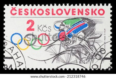 CZECHOSLOVAKIA - CIRCA 1984: A postage stamp printed in CZECHOSLOVAKIA shows cycling in 1984 Sarajevo Olympic games,  circa 1984 - stock photo