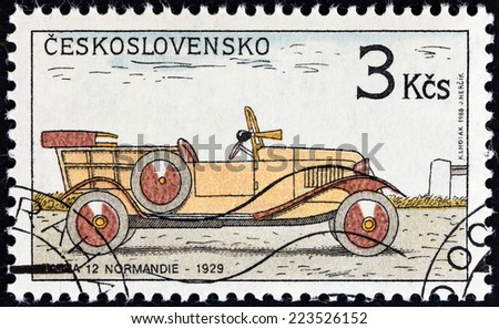 "CZECHOSLOVAKIA - CIRCA 1988: A stamp printed in Czechoslovakia from the ""Historic Motor Cars "" issue shows Tatra 12 Normandie, 1929, circa 1988.  - stock photo"