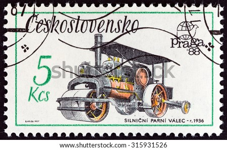 "CZECHOSLOVAKIA - CIRCA 1987: A stamp printed in Czechoslovakia from the ""Praga 88 International Stamp Exhibition. Technical Monuments "" issue shows Steam roller, 1936, circa 1987.  - stock photo"