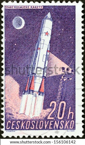 "CZECHOSLOVAKIA - CIRCA 1961: A stamp printed in Czechoslovakia from the ""Space Research (1st series)"" issue shows launching cosmic rocket, circa 1961.  - stock photo"