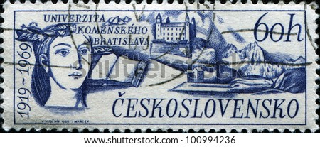 CZECHOSLOVAKIA - CIRCA 1969: A stamp printed in Czechoslovakia honoring 50th Anniversary Comenius University, shows Bratislava Castle, open book and head of woman , circa 1969 - stock photo