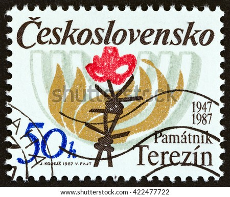 CZECHOSLOVAKIA - CIRCA 1987: A stamp printed in Czechoslovakia issued for the 40th anniversary of Terezin Memorial shows Barbed Wire, Flames and Menorah, circa 1987. - stock photo