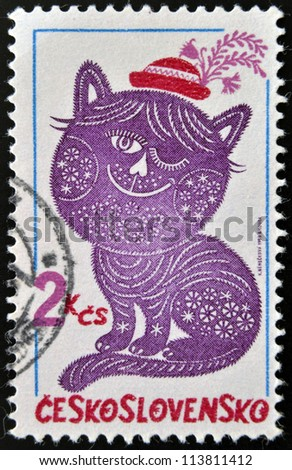 CZECHOSLOVAKIA - CIRCA 1980: A stamp printed in  Czechoslovakia, shown Folktale character embroideries, Dandy and Posy, circa 1980 - stock photo