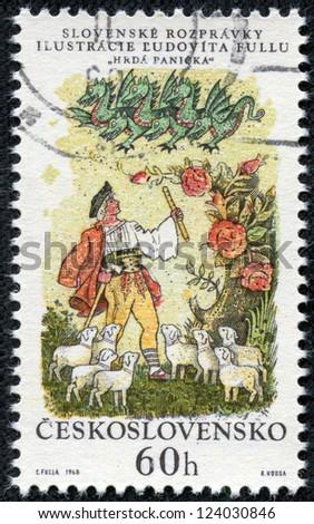 CZECHOSLOVAKIA - CIRCA 1968: A stamp printed in Czechoslovakia, shows a shepherd, sheep and green dragon, circa 1968 - stock photo