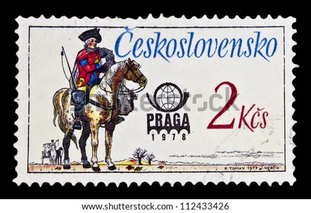 """CZECHOSLOVAKIA - CIRCA 1977: A stamp printed in Czechoslovakia, shows Austrian Postal Rider, 1770, with the inscription """"Prague 78"""", from the series """"International Stamp Exhibition"""", circa 1977 - stock photo"""