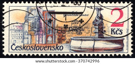 CZECHOSLOVAKIA - CIRCA 1988: A stamp printed in Czechoslovakia shows Exhibition emblem and Old Town Square, circa 1988 - stock photo
