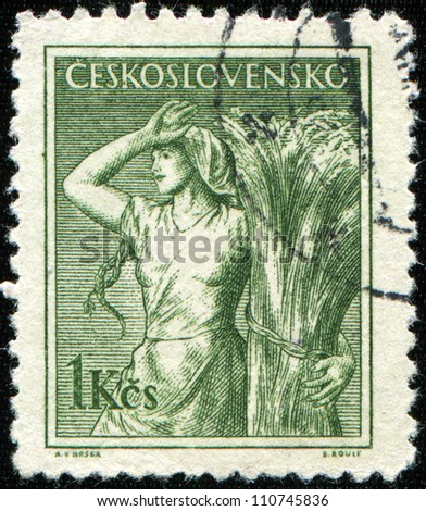 CZECHOSLOVAKIA - CIRCA 1954: A stamp printed in Czechoslovakia shows Girl and Sheaf of Corn, series, circa 1954