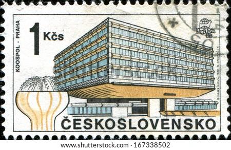 CZECHOSLOVAKIA - CIRCA 1988: A stamp printed in Czechoslovakia shows Koospol building, Praha,  circa 1988  - stock photo