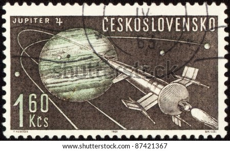 CZECHOSLOVAKIA - CIRCA 1963: A stamp printed in Czechoslovakia, shows Planet Jupiter and futuristic spaceship, series, circa 1963 - stock photo