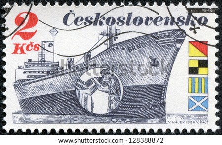 "CZECHOSLOVAKIA - CIRCA 1989: A stamp printed in Czechoslovakia shows the Czech Freighter Brno with inset showing a man peering at radar display. Flags spell ""OLGM"" in English, circa 1989. - stock photo"
