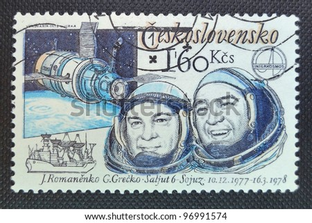 CZECHOSLOVAKIA - CIRCA 1979: A stamp printed in former CZECHOSLOVAKIA shows two Soviet astronauts Romanenko and Grecko, who were the first resident crew of  orbital space station Salyut 6, circa 1979 - stock photo
