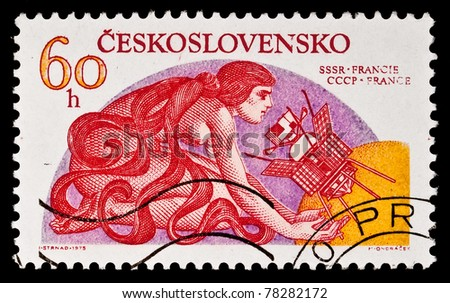 CZECHOSLOVAKIA - CIRCA 1975: A stamp printed in the Czechoslovakia shows image of the international space life, the woman and a spaceship, The Soviet-French project, circa 1975 - stock photo