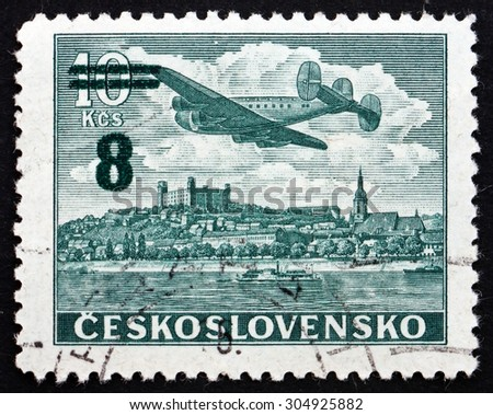 CZECHOSLOVAKIA - CIRCA 1946: a stamp printed in the Czechoslovakia shows Plane over Bratislava Castle, circa 1946