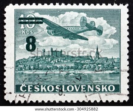 CZECHOSLOVAKIA - CIRCA 1946: a stamp printed in the Czechoslovakia shows Plane over Bratislava Castle, circa 1946 - stock photo