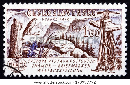 CZECHOSLOVAKIA - CIRCA 1961: a stamp printed in the Czechoslovakia shows Tatra Mountains, Boots, Ice Pick and Rope, circa 1961 - stock photo