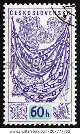 CZECHOSLOVAKIA - CIRCA 1958: a stamp printed in the Czechoslovakia shows Textiles, Issued for the Universal and International Exposition at Brussels, circa 1958 - stock photo