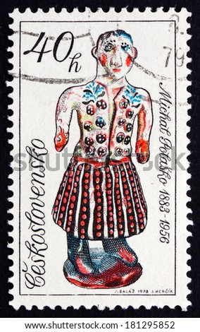 CZECHOSLOVAKIA - CIRCA 1978: a stamp printed in the Czechoslovakia shows Woman in Folk Costume by Michal Polasko, Slovak Ceramics, circa 1978 - stock photo