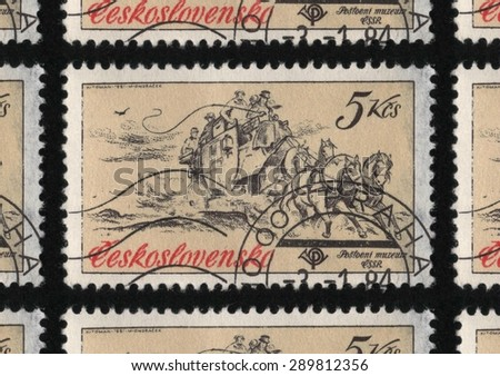 "CZECHOSLOVAKIA - CIRCA 1981: A used postage stamp printed in Czechoslovakia from the ""Historic Coaches in Postal Museum"" issue, shows a stage coach pulled by horses on the brow of a hill.  - stock photo"
